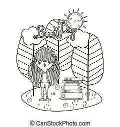 happy little girl reading books in the field