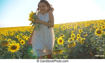 Happy little girl running happy free across the field with...