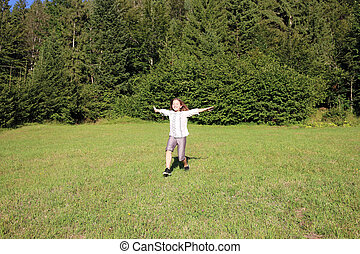 happy little girl running on field