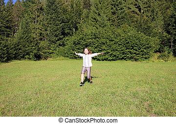 happy little girl running on field