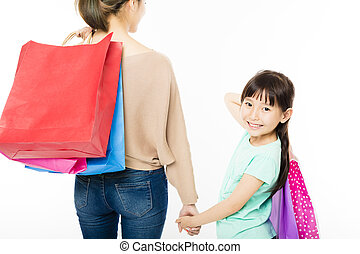 happy little girl shopping with mother
