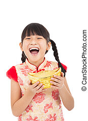happy little girl showing  gold for chinese new year
