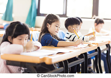 happy little girl studying  in the classroom