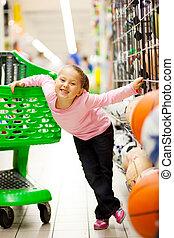 happy little girl supermarket