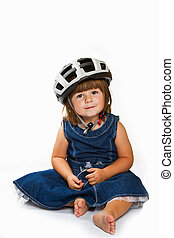 Happy little girl wearing helmet
