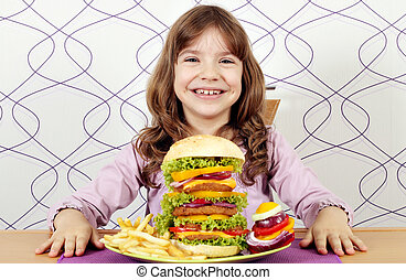 happy little girl with big hamburger