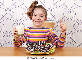 happy little girl with chocolate donuts