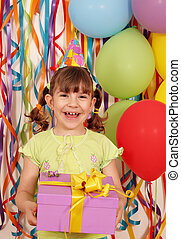 happy little girl with gift birthday party