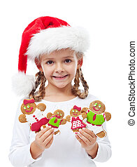 Happy little girl with gingerbread people family