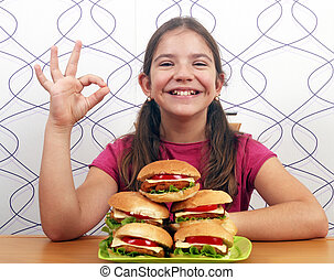 happy little girl with hamburgers and oh hand sign