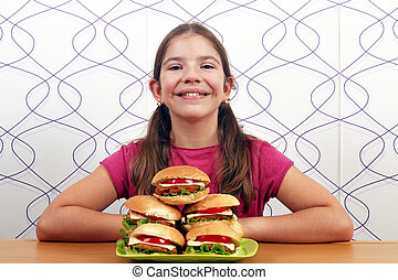 happy little girl with hamburgers fast food
