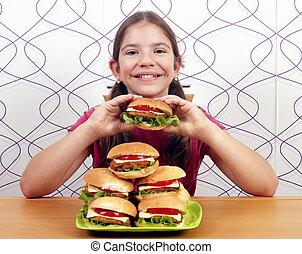 happy little girl with hamburgers