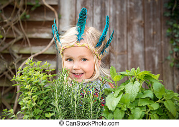 Happy little girl with herbs