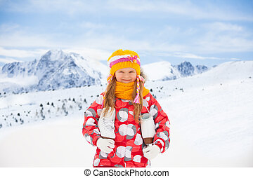 Happy little girl with ice skates