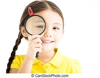 happy little girl with magnifying glass