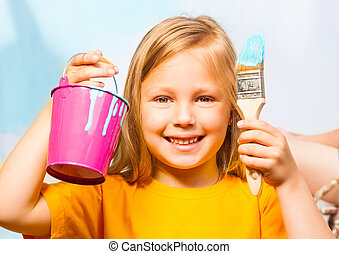 Happy little girl with painting accessories
