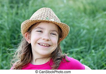 happy little girl with straw hat portrait