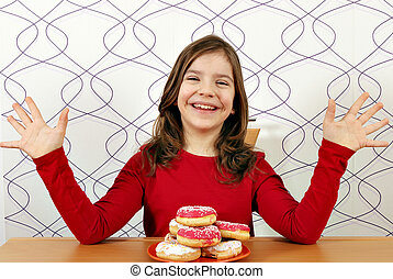 happy little girl with sweet donuts