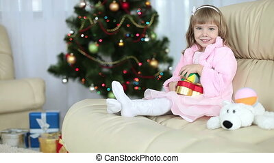 Happy little girl with toys sitting