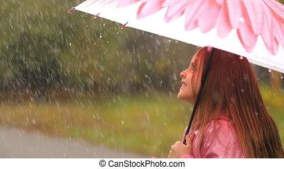 Happy Little Girl With Umbrella - Little girl is standing...