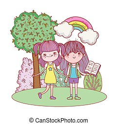 happy little girls reading books in the landscape