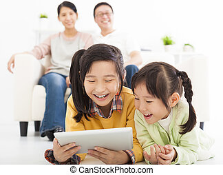 happy little girls using tablet computer
