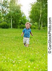 happy little kid running in park