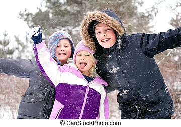 Happy Little Kids Playing Outside in the Winter Snow
