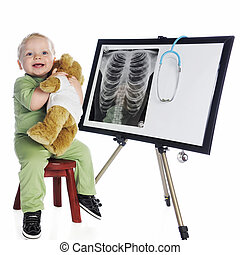 Happy Little Med-Tech - A happy baby hugging his bear while...