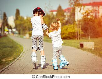 little sisters on roller skates