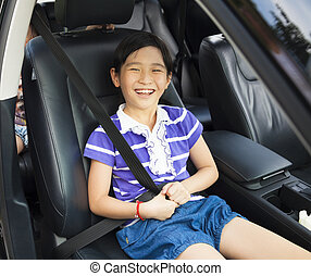 happy little sitting in the car with seat belt