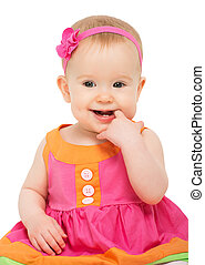 happy little sly baby girl in bright multicolored festive ...