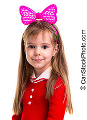 Happy little smiling blond girl in a red dress with a pink band bow on the white isolated background.
