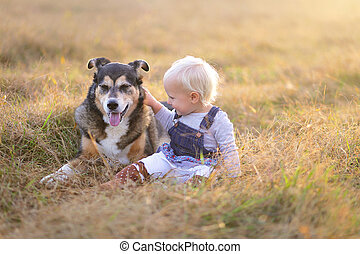Happy Little Toddler Girl Petting her German Shepherd Mix Breed Dog Outside