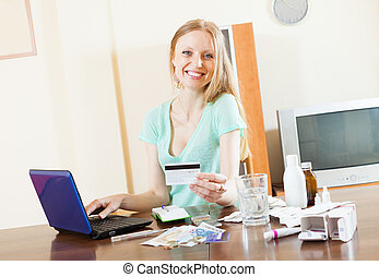 happy long-haired woman buying drugs online