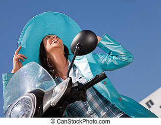 happy loughing moped - Happy woman with blue raincoat and ...