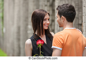 Happy loving couple. Cheerful young couple hugging while looking at each other