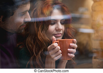 Happy loving couple drinking hot beverage indoors