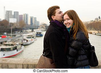 Happy loving couple in Paris at the Iena bridge