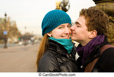 Happy loving couple in Paris at the Pont Alexandre III
