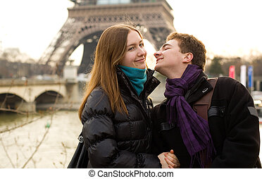 Happy loving couple in Paris near the Eiffel Tower