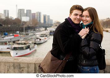 Happy loving couple in Paris on the Iena bridge