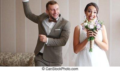 Happy loving couple of newlyweds. Romantic wedding moments