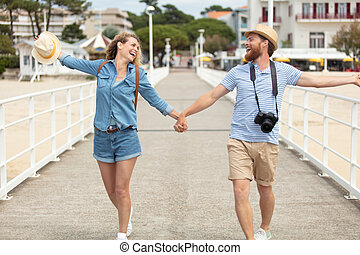 happy loving couple on a pier