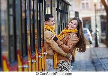 happy loving couple posing near a tram in the city Lviv.