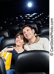 Happy Loving Couple Watching Film In Theater
