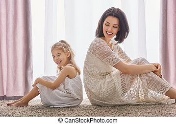 Happy loving family. Mother and her daughter child girl...