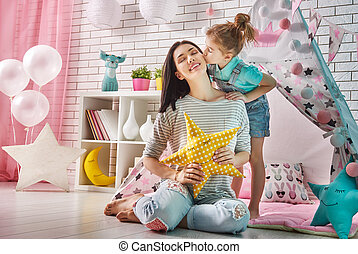 Happy loving family. Mother and her daughter girl play in...