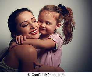 Happy loving mother and kid girl hugging. Portrait