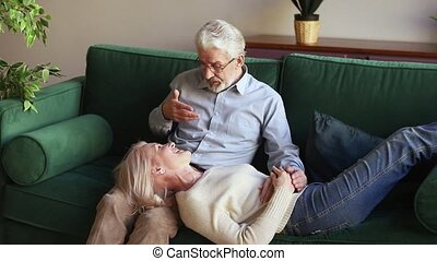 Happy loving senior old family couple relaxing on...
